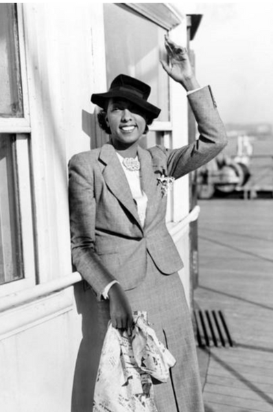 Josephine baker is a suit and hat
