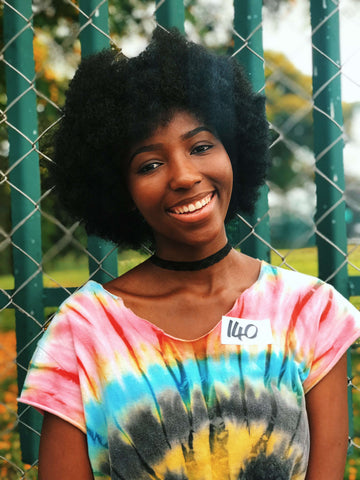 African girl wearing tie and dye shirt