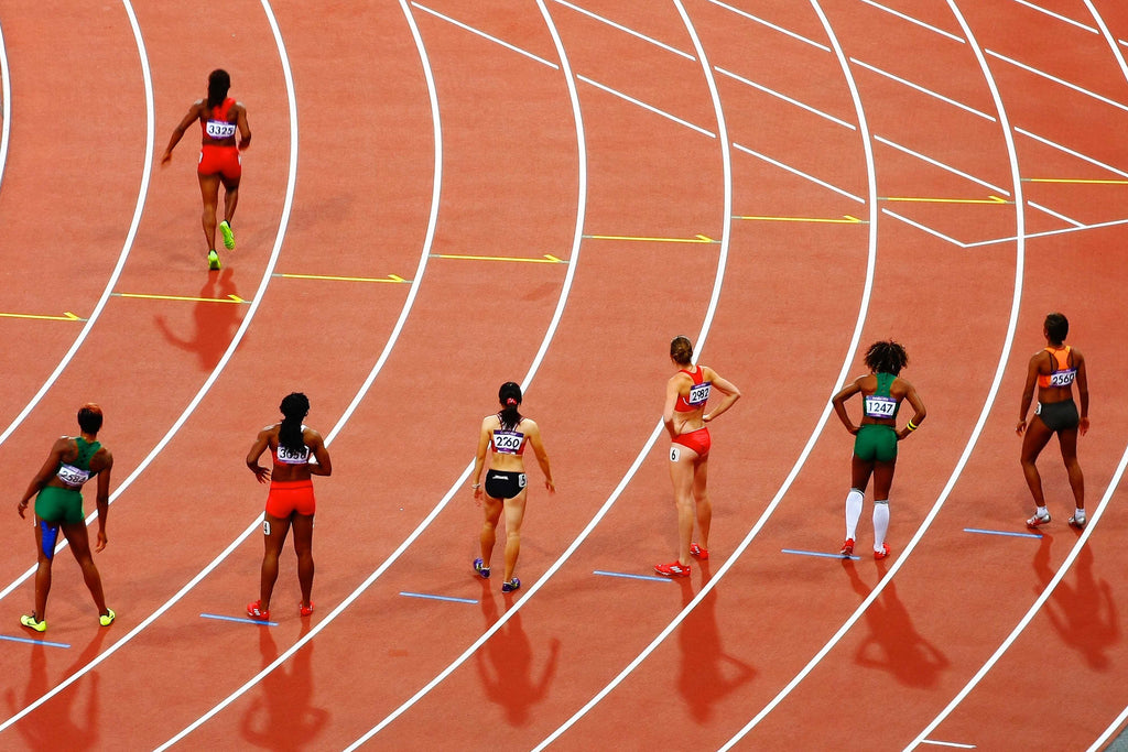 women runners on the race track