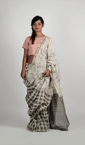 Kusha | Hand block dabu printed linen saree dyed with natural dyes