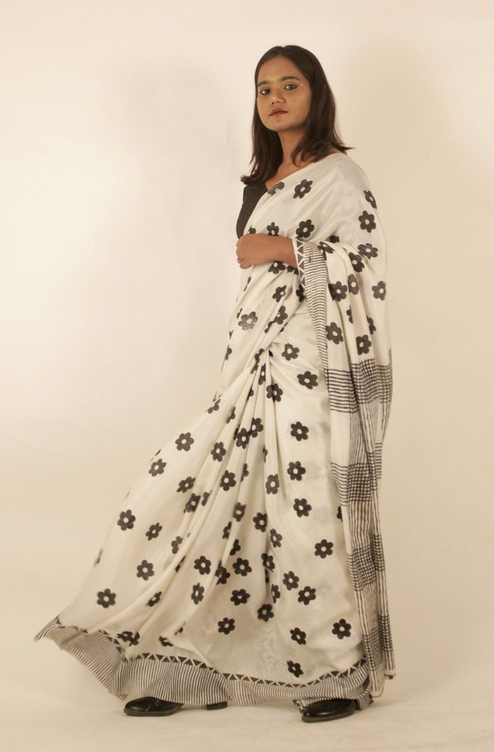 Kella | Pure silk saree with dabu print
