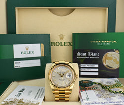 ROLEX 18kt Yellow Gold Day Date 40 President Silver Index Dial Model 228238