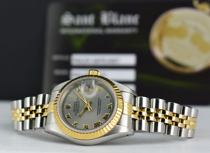 ROLEX Ladies 18kt Yellow Gold Stainless DateJust Silver Roman 69173