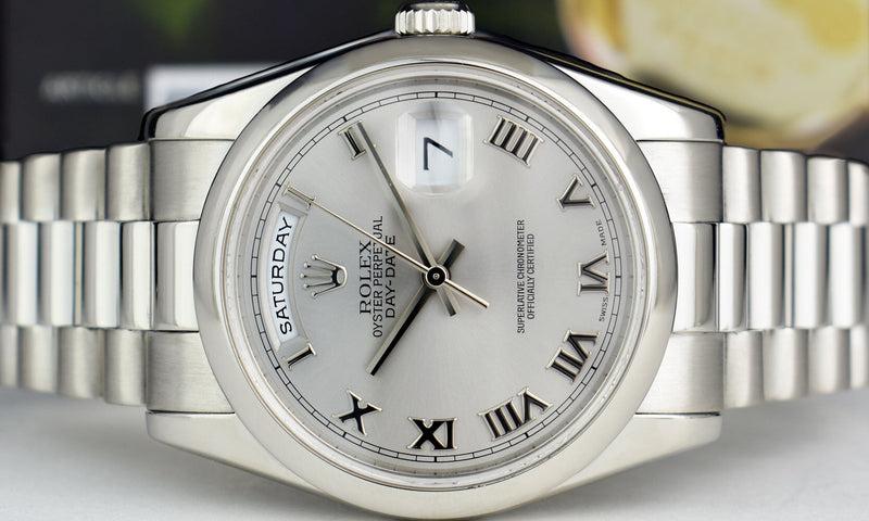 ROLEX Mens PLATINUM President Day Date Silver Roman Dial Fat Buckle 118206