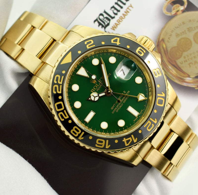 ROLEX 18kt Yellow Gold GMT Master II Green Dial Card Model 116718