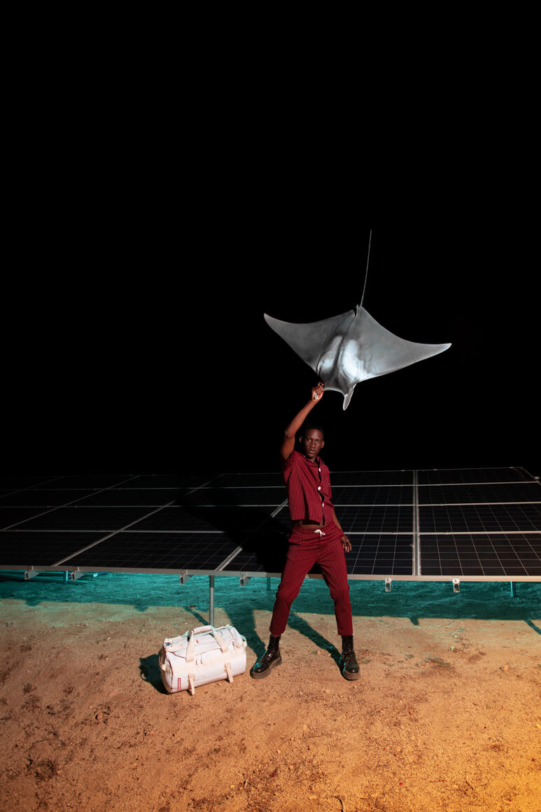centered image of man holding a stingray