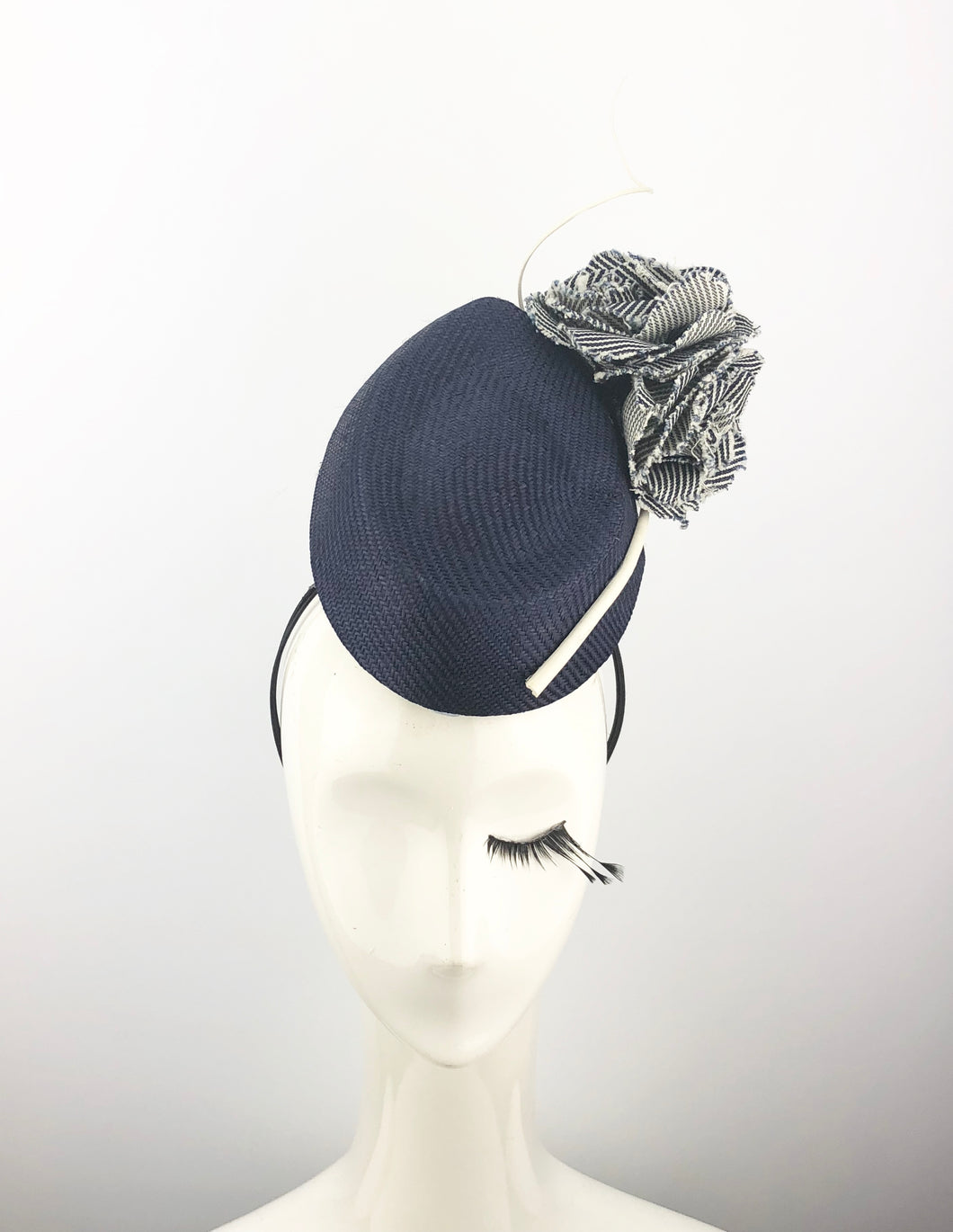Navy Straw Headpiece With Stripped Flowers