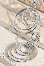 Turning in Circles Earrings - Silver or Gold