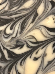 Black and white goats milk soap with swirl