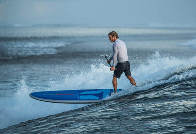 2019 Starboard Blend stand up paddle boarder surfing wave seen from behind
