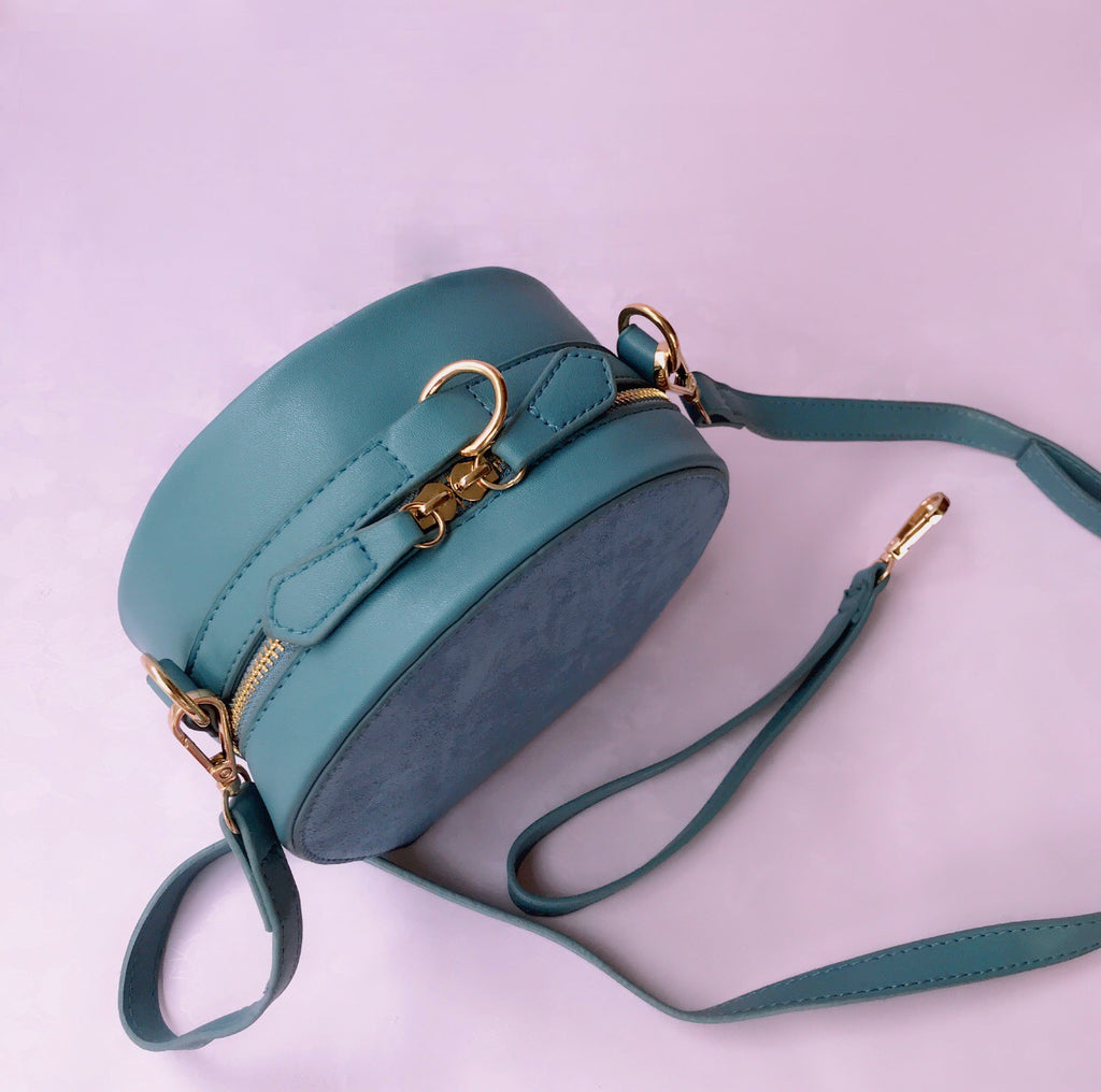 2 way round suede bag in blue