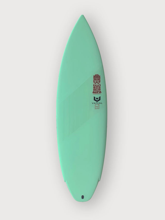 Akila Aipa twin surfboard with varial infused glass and varial foam for sale. 5'8 akila aipa, stringerless foam core, vacuum bag glassing, gree resin pigment, polished gloss band, twin surfboard, futures fins, in stock surfboard, akila aipa surfboard, performance surfboard, twin fin surfboard