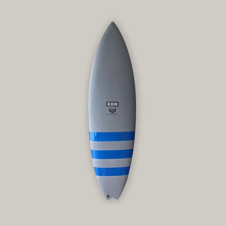 "Album surfboard for sale and in stock. 5'9"" album insanity model. High performance surfboard with standard glass, futures fins, infused glass and varial foam. Slate grey with royal blue gloss bands surfboard art."