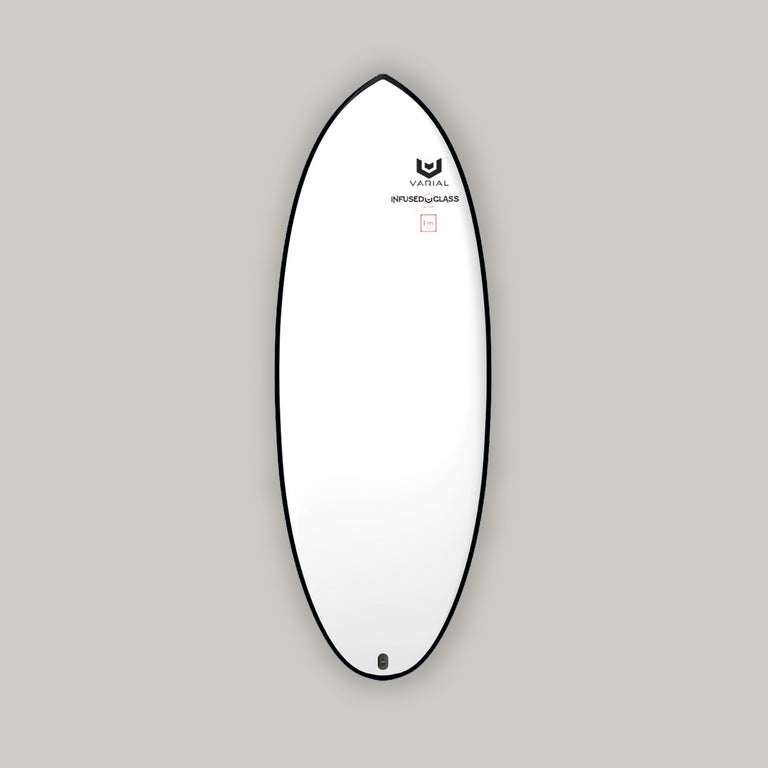 Foil board deck image. Strong custom foil surfboard with tri-planed hull, round tail, concave deck, deep chined rails and straight thick tail.