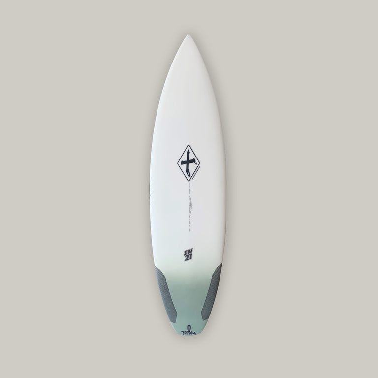 Xanadu surfboard 5'11 SW21 with varial surf technology infused glass and varial foam. Xanadu performance surfboard, 3-fin futures, standard glass, polyester resin, army green airbrush tail fade, carbon tail hits. Xanadu surfboard logos and varial logos.