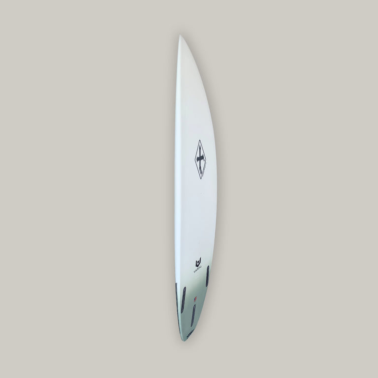Xanadu surfboards 5'11 SW21 with varial surf technology infused glass and varial foam. Xanadu performance surfboard, 3-fin futures, standard glass, polyester resin, army green airbrush tail fade, carbon tail hits. Xanadu surfboard logos and varial logos.