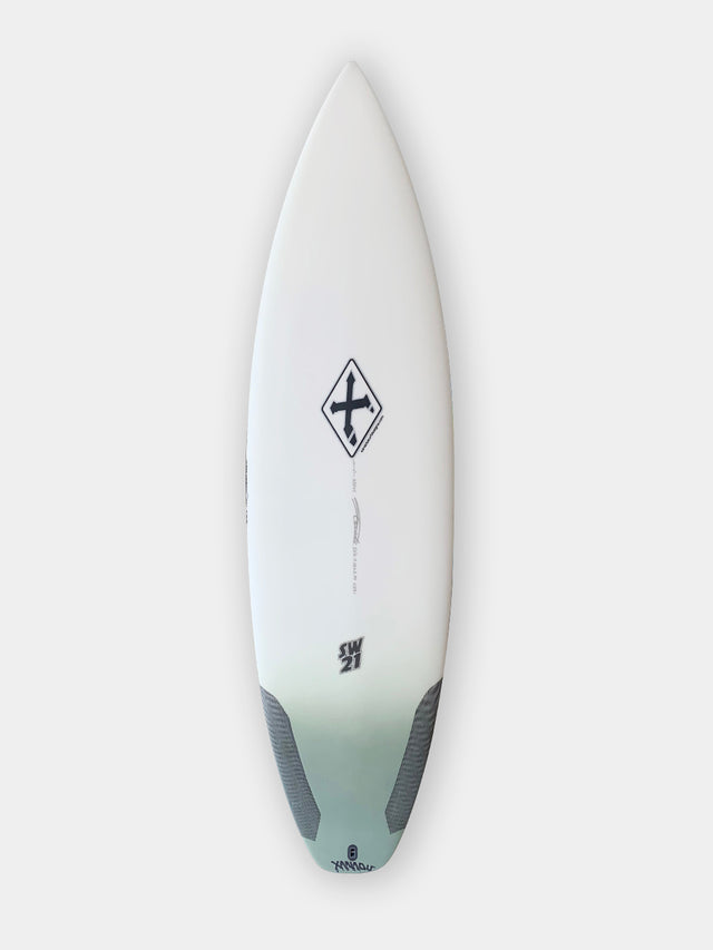 Xanadu SW21 surfboard with varial infused glass and varial foam. 5'11 Xanadu performance surfboard, 3-fin futures, standard glass, polyester resin, army green airbrush tail fade, carbon tail hits