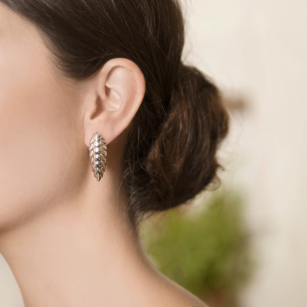 Model Wearing Pangolin Haka Earrings in Sterling Silver