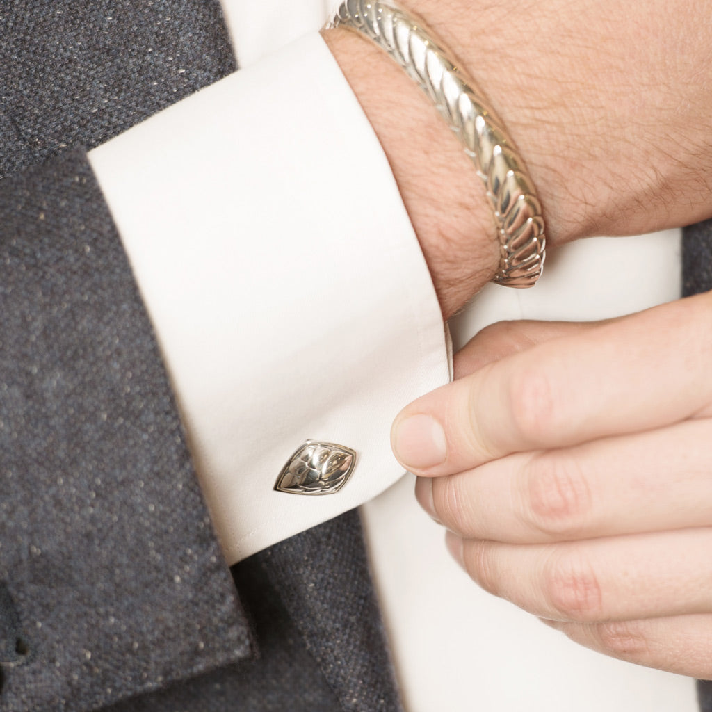Model Wearing Pangolin Shield Cufflinks in Sterling Silver and Pangolin Armour Bangle in Sterling Silver