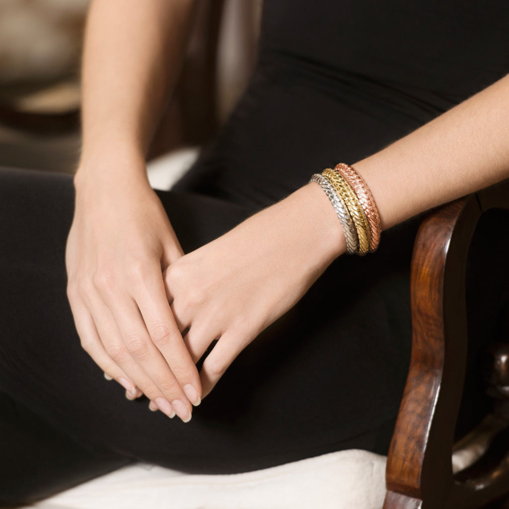 Model Wearing Pangolin Stacking Cuff in Sterling Silver, 18t Gold and 18ct Rose Gold