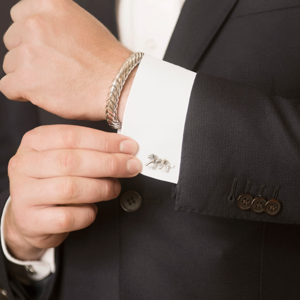 Model Wearing Walking Lion Cufflinks in Sterling Silver and Pangolin Armour in Sterling Silver Bangle