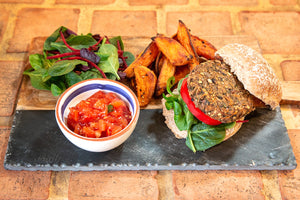 Bean burger with salsa & sweet potato wedges