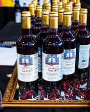 Load image into Gallery viewer, Best non alcoholic drinks, mocktail for the sober and sober-curious. Premade alcohol free drinks. Made of spiced hibiscus roselle. Buy non alcoholic sorrel mocktail drinks online. Caribbean drinks. Brooklyn made. Black owned business. Woman owned business. Caribbean food. Sorrel drink. Holiday drinks