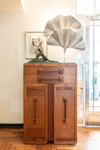 Art deco details fill the hotel like this cabinet and lamp in the lobby