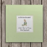 Personalised Peter Rabbit Little Book of Virtue laid flat on wooden boards