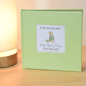 Personalised Peter Rabbit Little Book of Virture Book. Light Green Hardback Book. Standing.