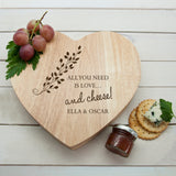 Personalised Wooden Heart Shaped Cheeseboard with delicate leaf design. Perfect gift for couples.