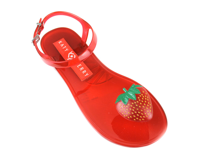 Katy Perry Gelli , Open toe Sandals with toepost and ankle strap closing, these Gelli Sandals red in colour and have strawberry design at the toe post. They also have a scent of strawberry, Shoe Style International