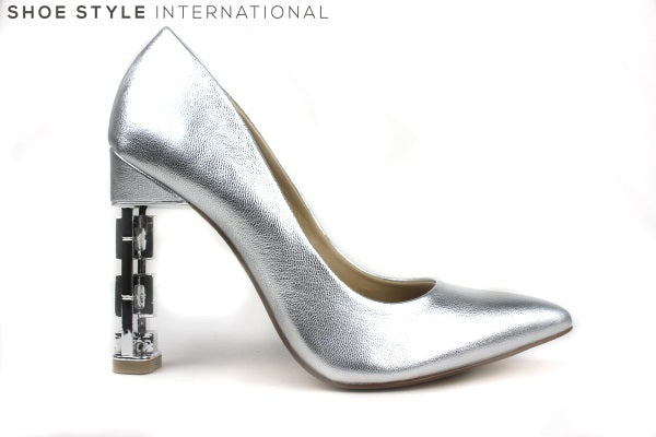 Katy Perry Suzanne High Heel Closed toe court shoe, The heel is silver with a chain detail. Block shoe colour: Silver Metallic. Shoe Style International Wexford Gorey Ireland