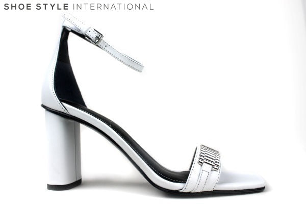 Kendall + Kylie, Lake Sandals, Open toe sandals with strap across the front with chain detail in colour silver. The block colour of the shoe is white. Closing on the shoe is an ankle strap buckle. Shoe Style International Wexford Gorey Ireland