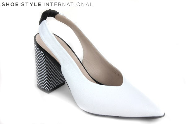Lodi Rinatio is a pointed closed toe slingback block heel. Colour is White and block heel designed with black and white. The Slingback is elasticated. Perfect shoe for any occasion dress up or down. Shoe Style International, Wexford, Goreyy, Ireland