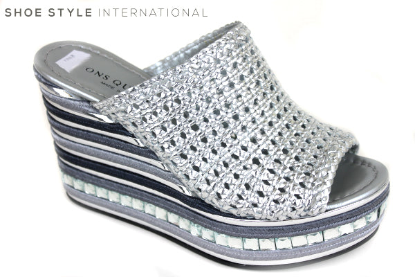 Pons Quintana 7008, slip-on wedge sanal with a peep-toe. Colour Silver. Material is a woven leather. Row of diamante detrail on the wedge. Shoe Style International Wexford Gorey Ireland