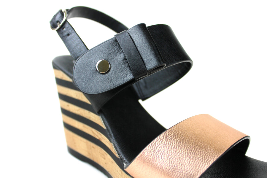 Repo 55231, Sling-back Open toe Wedge. Colour is Rose Gold and Black. Rose Gold strap across the front of the Wedge. Second Strap with bow detail at the top of the foot colour black. Shoe Style International Wexford Gorey Ireland