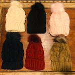 Fleece lined hat with matching pom