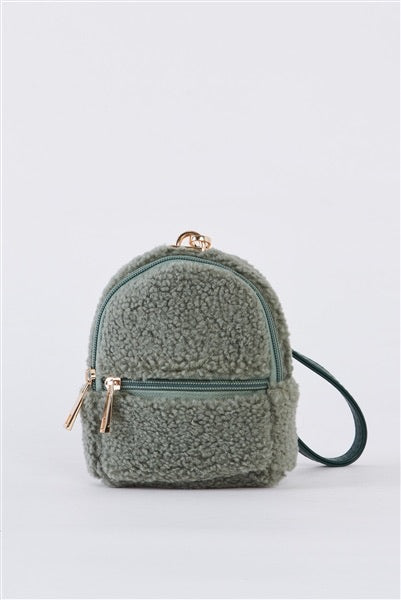 Mini Faux shearling backpack wristlet