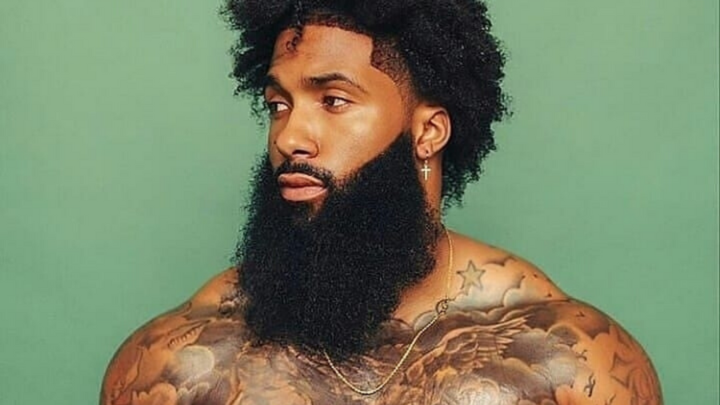 man with a long dark beard with tattoos