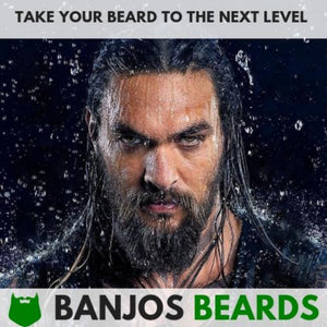 A bearded model using banjos beard's natural beard care grooming kit to grow his beard