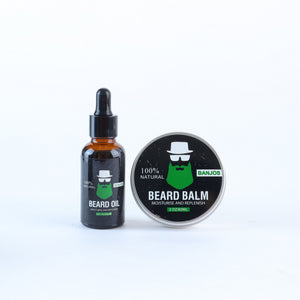 Beard balm tin and beard oil container with green beard logo of banjos beards in black packaging
