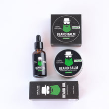Load image into Gallery viewer, Beard growth balm and beard care oils with green beard logo of banjos beards in black packaging