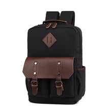 Load image into Gallery viewer, Black mens backpack with brown leather accents shown with two large pockets and the banjos beards logo