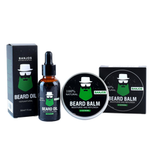 Load image into Gallery viewer, Beard balm and beard oils lined up side by side with green beard logo of banjos beards in black packaging