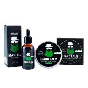 Beard balm and beard oils lined up side by side with green beard logo of banjos beards in black packaging