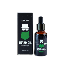 Load image into Gallery viewer, Beard Oil with green beard logo of banjos beards in black packaging next to the beard oils box