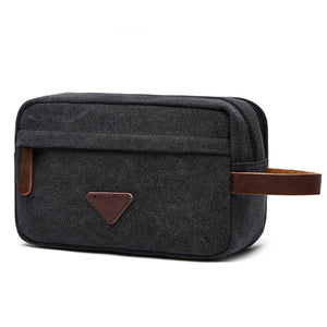 Black mens wash bag with brown leather accents and three seperate pockets
