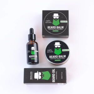 Beard balm and beard oils with green beard logo of banjos beards in black packaging as part of the beard care kit