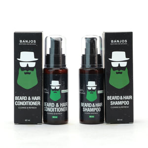 beard wash and beard conditioner bottle next to the black boxes that house them. There is green and white text as well as the banjos logo.